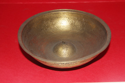 A Bowl Heavily Inscribed in Arabic and Containing the Zodiac